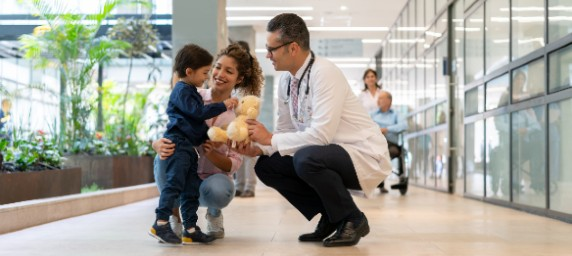 Pediatrician with patient