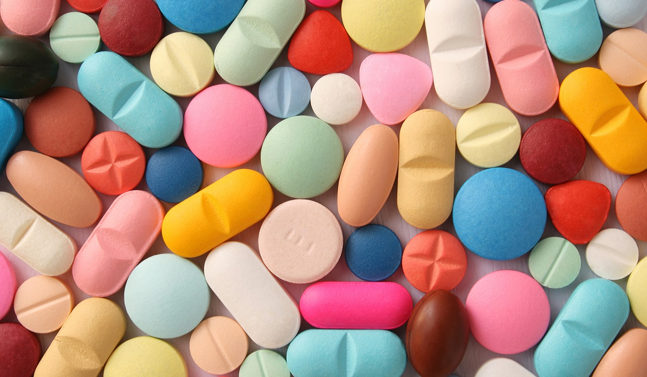 An assortment of brightly colored pills.