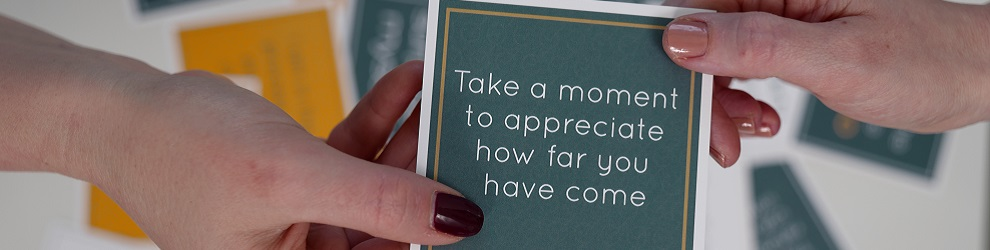 A motivational card that reads, Take a moment to appreciate how far you've come.
