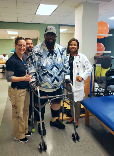 Anthony stands with his rehabilitation team at Memorial Hermann Rehabilitation Hospital - Katy