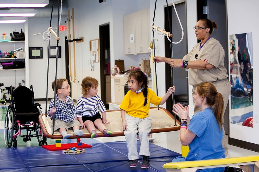 Children doing rehab together with therapists