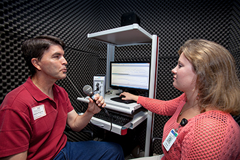 Man participating in speech therapy