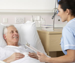 Older patient talking with doctor