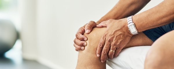 Patient holding knee in pain