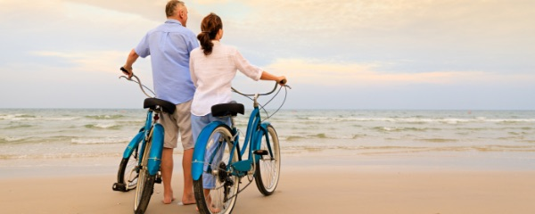 A couple on the beach with bikes