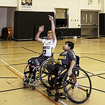 Two Boys Playing Basketball in Wheelchairs